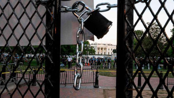 PHOTO: A locked padlock keeps a metal fence recently erected in front of the White House and meant to keep protestors at bay closed on June 2, 2020. (Roberto Schmidt/AFP via Getty Images)