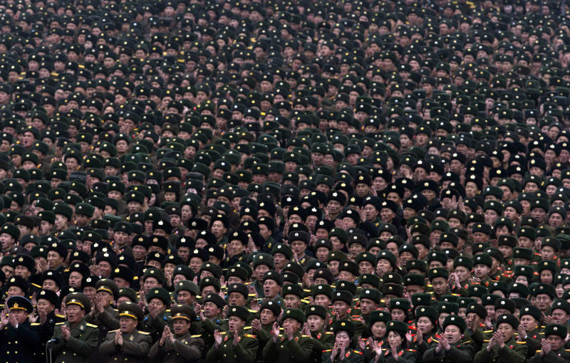 North Korean soldiers attend a mass rally organized to celebrate the success of a rocket launch that sent a satellite into space, on Kim Il Sung Square in Pyongyang, North Korea, Friday, Dec. 14, 2012. As the U.S. led international condemnation of what it calls a covert test of missile technology, top North Korean officials denied the allegations and maintained the country's right to develop its space program. (AP Photo/Ng Han Guan)