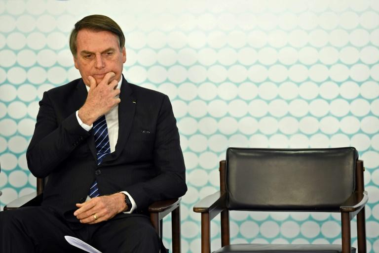 (FILES) In this file photo taken on September 06, 2019, Brazilian President Jair Bolsonaro gestures during the launching ceremony of the new student ID at Planalto Palace in Brasilia