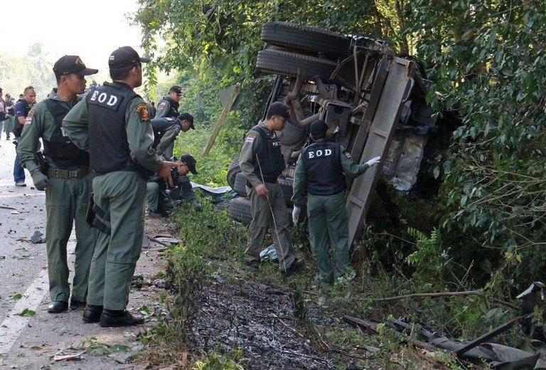 Officials inspect a damaged military patrol vehicle in Yala, southern Thailand, on February 10, 2013