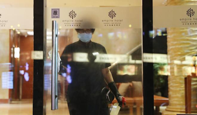 A cleaner disinfects a door at the Empire Hotel in Tsim Sha Tsui. Photo: Sam Tsang