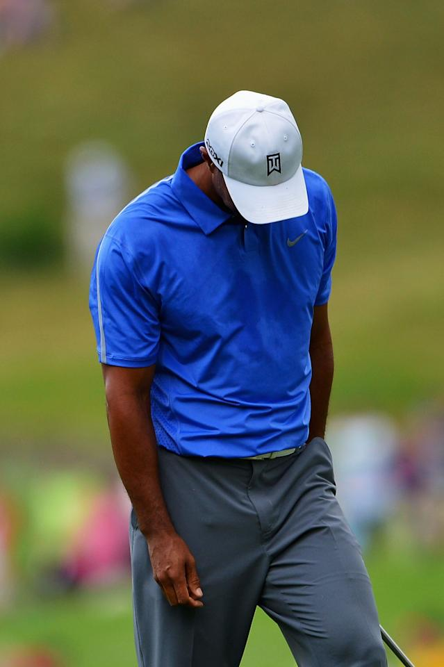 ARDMORE, PA - JUNE 13: Tiger Woods of the United States reacts on the second hole during Round One of the 113th U.S. Open at Merion Golf Club on June 13, 2013 in Ardmore, Pennsylvania.  (Photo by Drew Hallowell/Getty Images)