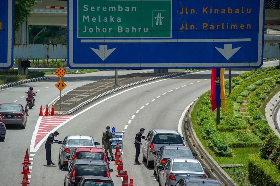 The federal government today announced a relaxation to its 10km limit nationwide even as it kept the ban against travel across state lines . — Picture by Shafwan Zaidon