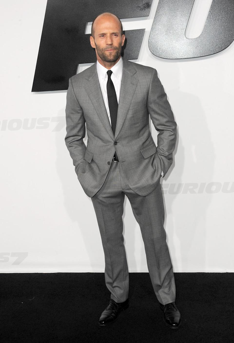 """The eternal action star showed up to the """"Furious 7"""" premiere in a gray suit and black tie that would most likely get the seal of sartorial approval from his lady love Rosie Huntington-Whiteley."""
