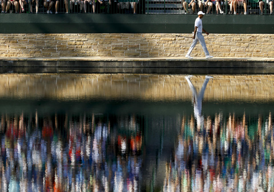 Tiger Woods walks to the 15th green during practice for the Masters golf tournament at Augusta National Golf Club, Tuesday, April 3, 2018, in Augusta, Ga. (AP Photo/Charlie Riedel)