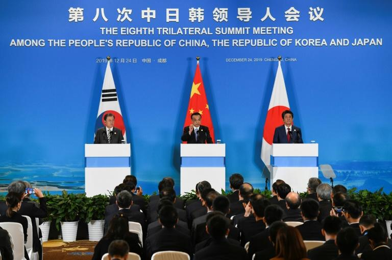 China, Japan and South Korea held a summit on Tuesday that also touched on a planned free-trade agreement between the three nations (AFP Photo/WANG ZHAO)