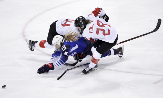 <p>Gigi Marvin (19), of the United States, collides between Renata Fast (14), of Canada, and Marie-Philip Poulin (29), of Canada, during the first period of the women's gold medal hockey game at the 2018 Winter Olympics in Gangneung, South Korea, Thursday, Feb. 22, 2018. (AP Photo/Matt Slocum) </p>