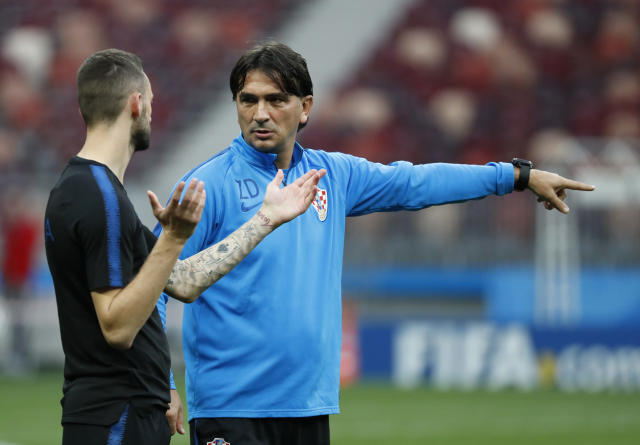Croatia head coach Zlatko Dalic, right, talks with Croatia's Marcelo Brozovic during a training session at Luzhniki Stadium on the eve of the semifinal match between Croatia and England at the 2018 soccer World Cup in Moscow, Russia, Tuesday, July 10, 2018. (AP Photo/Rebecca Blackwell)