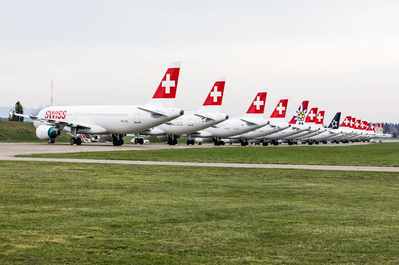 Dübendorf, Switzerland - March 26, 2020: A large lineup of grounded Swiss and Edelweiss Airbus A320/321 at Militärflugplatz Dübendorf. The coronavirus crisis is hitting the aviation industry hard.