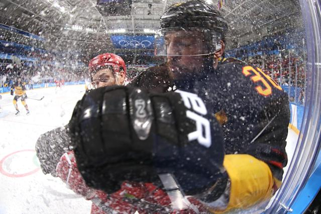 <p>Pavel Datsyuk #13 of Olympic Athlete from Russia collides with Yannic Seidenberg #36 of Germany in the third period during the Men's Gold Medal Game on day sixteen of the PyeongChang 2018 Winter Olympic Games at Gangneung Hockey Centre on February 25, 2018 in Gangneung, South Korea. (Photo by Jamie Squire/Getty Images) </p>