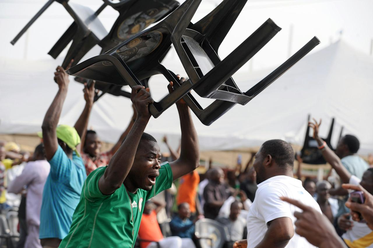 Nigerian football fans raise their chairs to celebrate Nigeria's goal against Mali during the first semi-final football match between the two teams at a public viewing centre in Lagos, on February 6, 2013. Nigeria defeated Mali 4 - 1 to qualify for the final of the 2013 African Cup of Nations in Durban.   AFP PHOTO/PIUS UTOMI EKPEIPIUS UTOMI EKPEI/AFP/Getty Images