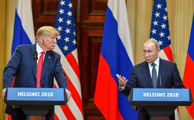 President Trump listens as Russian President Vladimir Putin speaks during a joint press conference after a meeting at the Presidential Palace in Helsinki on July 16, 2018. (Photo: Yuri Kadobnov/AFP/Getty Images)