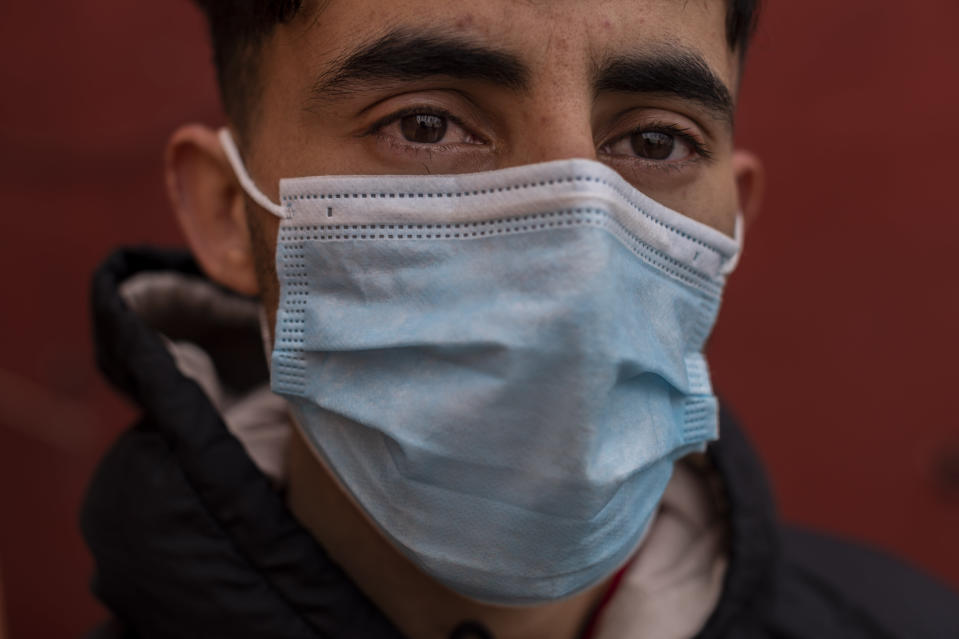 A migrant who crossed into Spain on Monday, in the enclave of Ceuta, next to the border of Morocco and Spain, Thursday, May 20, 2021. (AP Photo/Bernat Armangue)