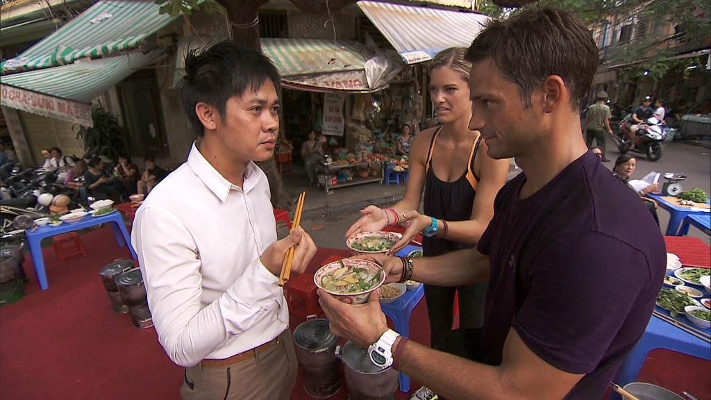 """Your Tan is Totally Cool"" -- In Detour B, Newlyweds Katie (center) and Max (right) must gather the ingredients and then make a Vietnamese soup called Pho Ga in order to receive the next clue on ""The Amazing Race."""