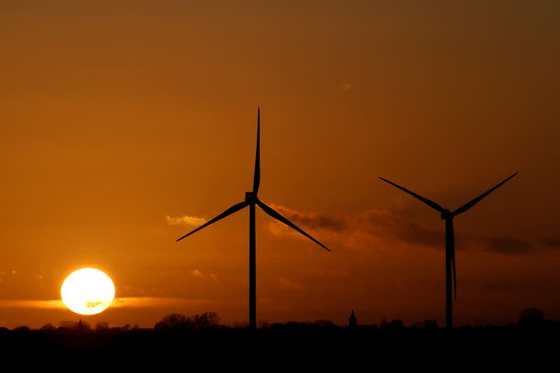 FILE PHOTO: Power-generating windmill turbines are seen at a wind park in Flesquieres