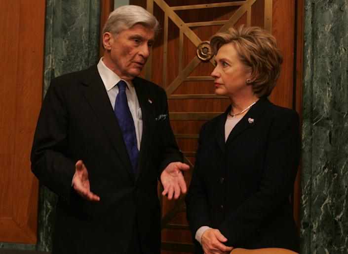 Sens. John Warner, R-Va., and Hillary Clinton, D-N.Y., in Washington, D.C. on Feb. 23, 2006. A decade later he supported her for president.