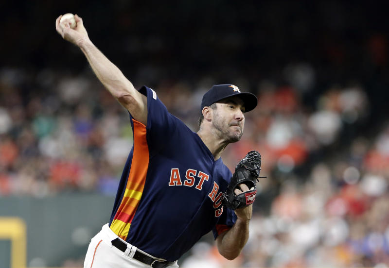 Houston Astros starting pitcher Justin Verlander throws during the first inning of a baseball game against the Seattle Mariners, Sunday, Aug. 4, 2019, in Houston. (AP Photo/Michael Wyke)