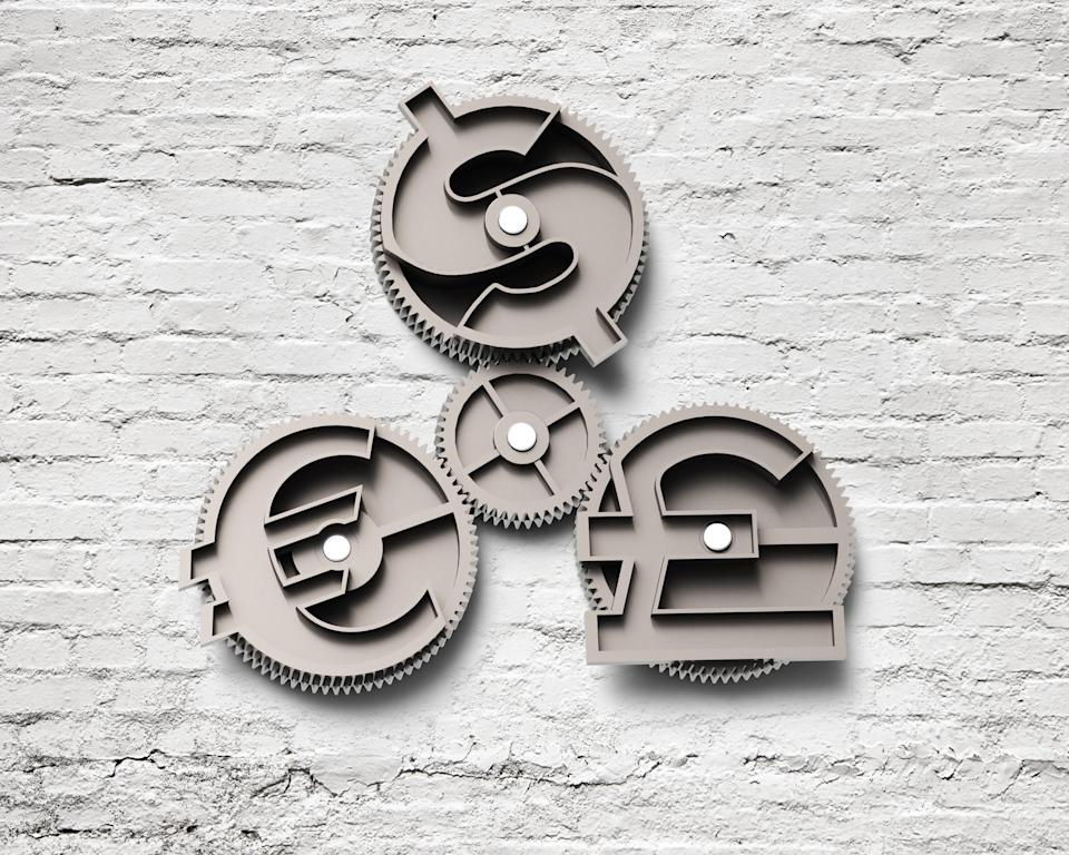 Gears with dollar sign, pound and euro symbol, on bricks wall background.