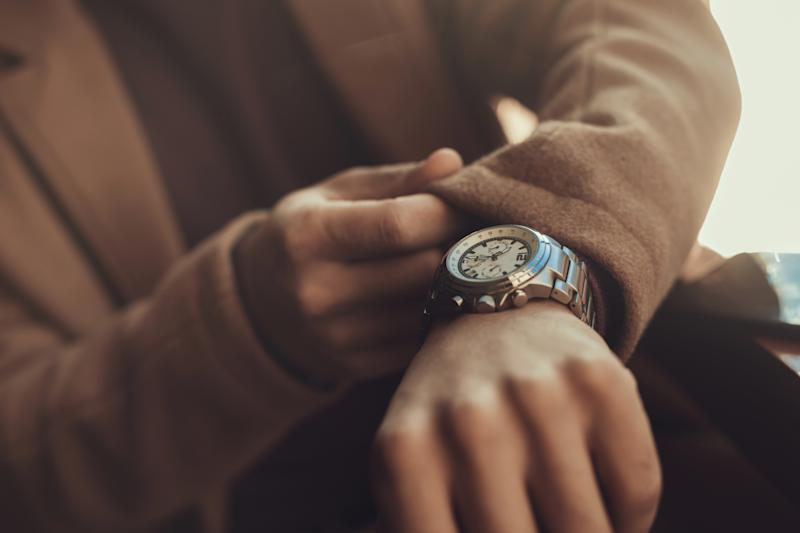 Being punctual. Close up male hand with stylish silver watch