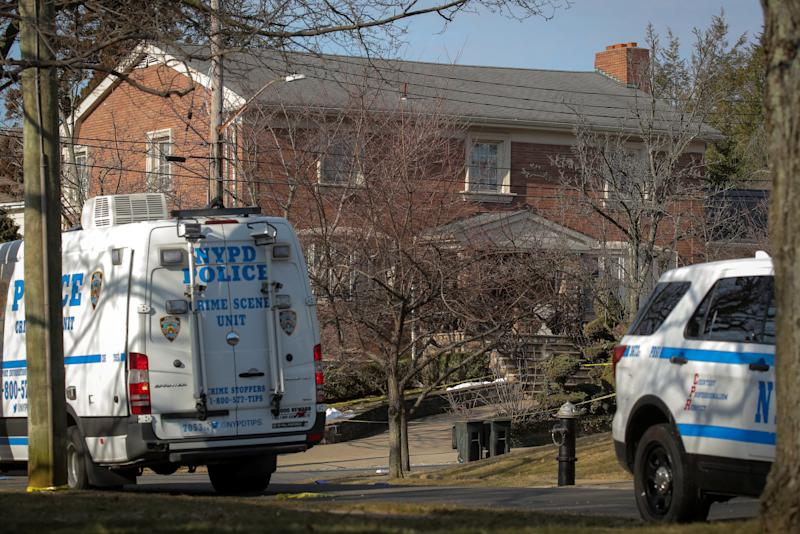 NYPD vehicles are parked at the scene where reported New York Mafia Gambino family crime boss was killed outside his home in the Staten Island borough of New York