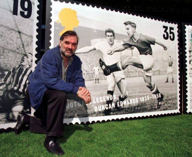 FILE PHOTO: Manchester United great George Best poses with a life-size version of a Royal Mail stamp featuring former United midfielder Duncan Edwards.