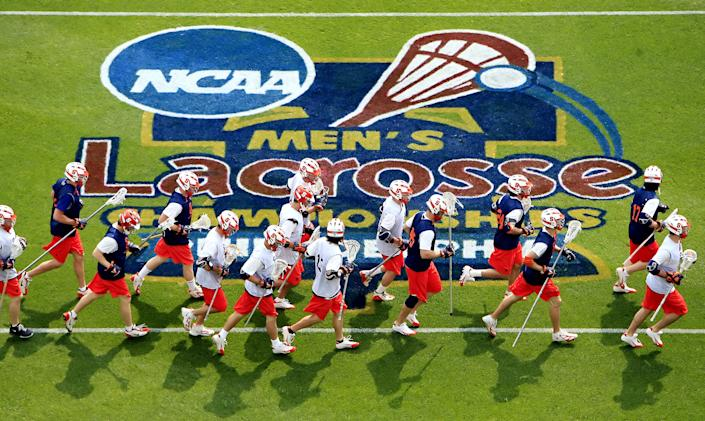 Members of the Syracuse University men's lacrosse team practice Friday, May 26, 2006, in preparation for their match with Virginia in the semifinals of the NCAA Men's Lacrosse Division I semifinals Saturday, at Lincoln financial Field in Philadelphia.  (AP Photo/Matt Rourke)