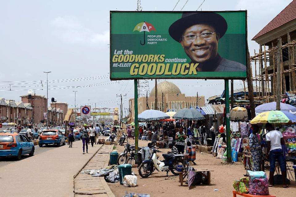 A campaign billboard of Nigerian President Goodluck Jonathan and candidate of the ruling Peoples Democratic Party (PDP) is displayed in downtown Akure, Ondo State, on March 23, 2015 (AFP Photo/Pius Utomi Ekpei)