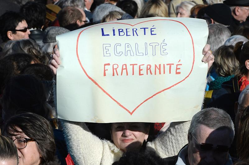 "A woman holds a sign reading ""Freedom, equality, brotherhood"" during a demonstration attended by an estimated 45.000 in Marseille, southeastern France, on January 10, 2015 (AFP Photo/Boris Horvat )"