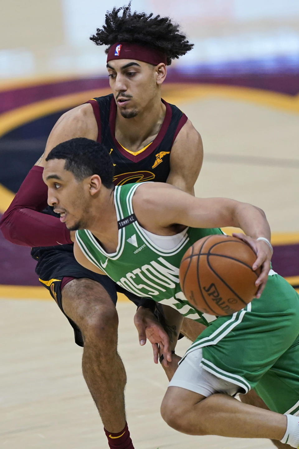 Boston Celtics' Tremont Waters (51) drives against Cleveland Cavaliers' Brodric Thomas (33) during the first half of an NBA basketball game, Wednesday, May 12, 2021, in Cleveland. (AP Photo/Tony Dejak)