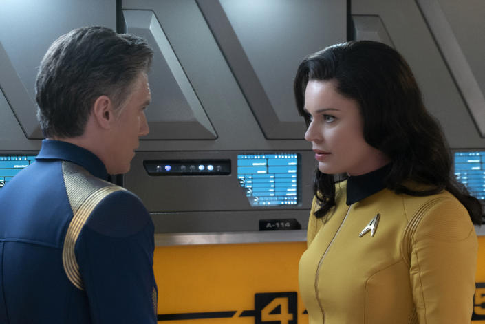 Capt. Pike (Anson Mount) consults with Number One (Rebecca Romijn), reporting from the starship Enterprise. <cite>Michael Gibson/CBS</cite>