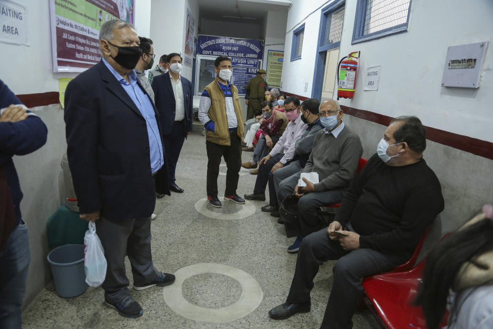 Elderly Indian wait to receive COVID-19 vaccine at the Government Medical College hospital in Jammu, India, Monday, March 1, 2021. India is expanding its COVID-19 vaccination drive beyond health care and front-line workers, offering the shots to older people and those with medical conditions that put them at risk. (AP Photo/Channi Anand)