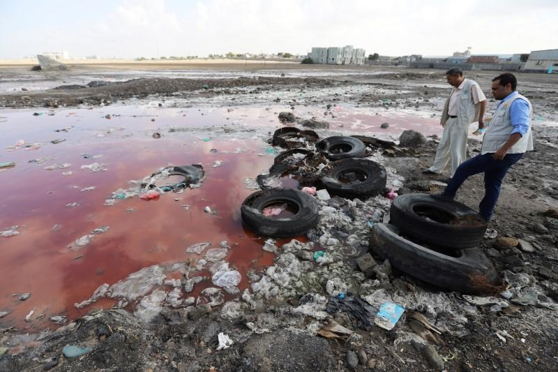 Health workers check stagnant water pools which could server as potential breeding sites of Aedes aegypti mosquitoes, known to spread the dengue fever, in Hodeidah