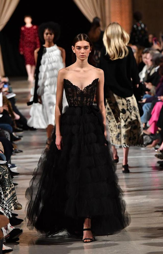 <p>A black strapless gown at the Oscar de la Renta FW18 show. (Photo: Getty) </p>