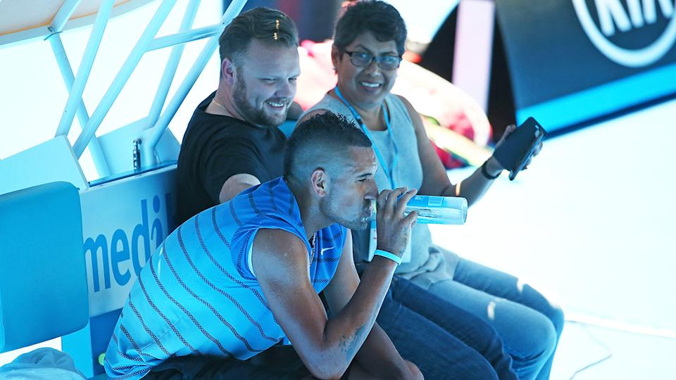 Nick Kyrgios, pictured here with his manager John Morris and mother Norlaila at the Australian Open in 2016.