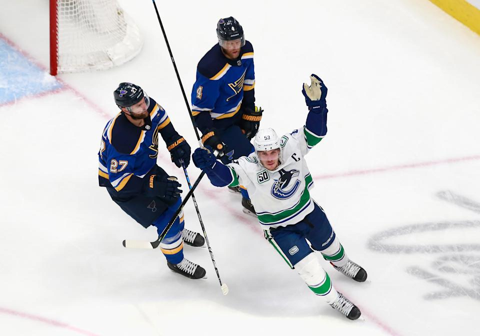 EDMONTON, ALBERTA - AUGUST 14: Bo Horvat #53 of the Vancouver Canucks scores the game winner at 5:55 of overtime against Jordan Binnington #50 of the St. Louis Blues in Game Two of the Western Conference First Round during the 2020 NHL Stanley Cup Playoffs at Rogers Place on August 14, 2020 in Edmonton, Alberta, Canada. The Canucks defeated the Blues 4-3 in overtime. (Photo by Jeff Vinnick/Getty Images)