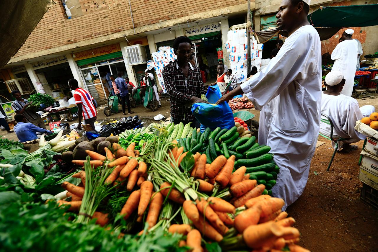 A man waits to buy food at a market in Khartoum July 28, 2016. REUTERS/Mohamed Nureldin Abdallah