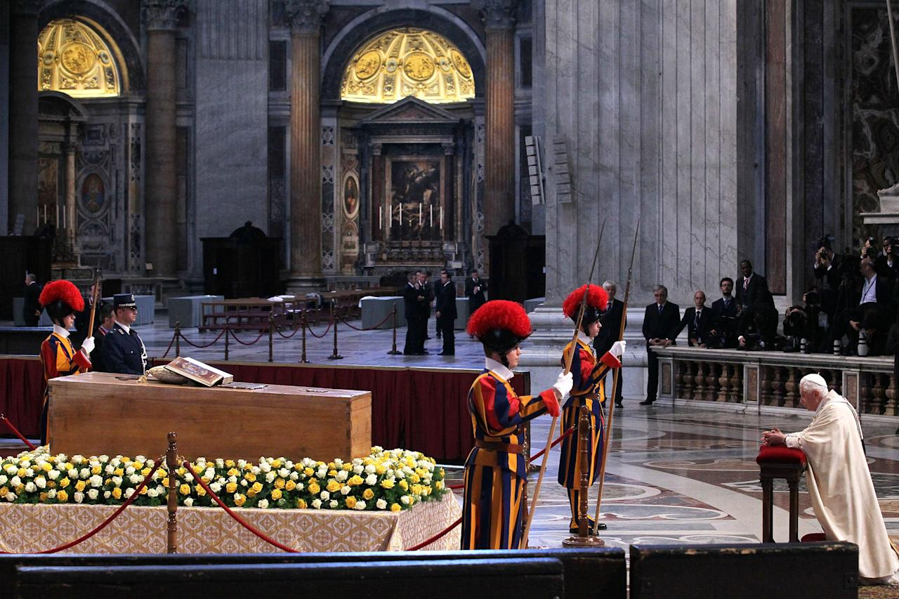 VATICAN CITY, VATICAN - MAY 01:  Pope Benedict XVI prays in front of the coffin of John Paul II at St. Peter's Basilica at the end of John Paul II Beatification Ceremony on May 1, 2011 in Vatican City, Vatican. The ceremony marking the beatification and the last stages of the process to elevate Pope John Paul II to sainthood was led by his successor Pope Benedict XI and attended by tens of thousands of pilgrims alongside heads of state and dignitaries.  (Photo by Vatican Pool/Getty Images)