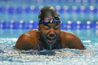 Simone Manuel reacts after winning the women's 50 freestyle during wave 2 of the U.S. Olympic Swim Trials on Sunday, June 20, 2021, in Omaha, Neb. (AP Photo/Jeff Roberson)