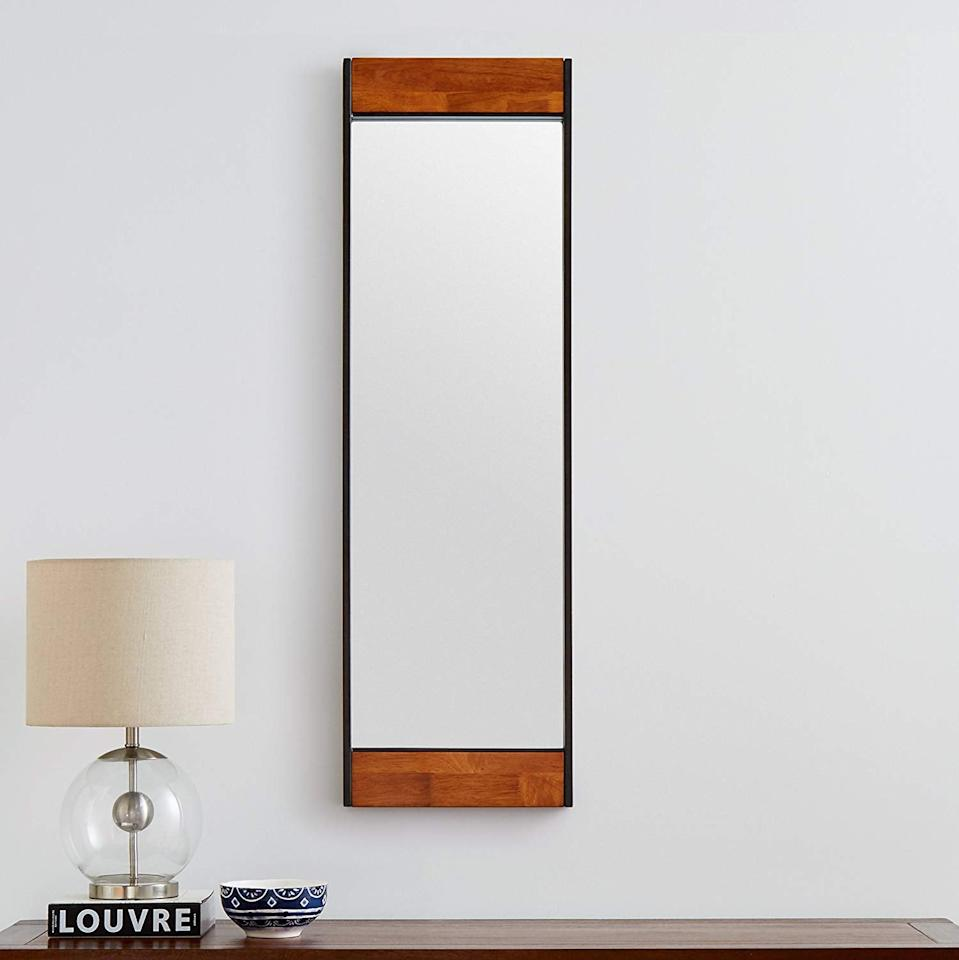 "<p>This <a href=""https://www.popsugar.com/buy/Rivet%20Wood%20and%20Iron%20Rectangular%20Mirror-449571?p_name=Rivet%20Wood%20and%20Iron%20Rectangular%20Mirror&retailer=amazon.com&price=122&evar1=casa%3Aus&evar9=46178542&evar98=https%3A%2F%2Fwww.popsugar.com%2Fhome%2Fphoto-gallery%2F46178542%2Fimage%2F46178867%2FRivet-Wood-Iron-Rectangular-Mirror&list1=amazon%2Cmirrors%2Cshoppping%2Chome%20shopping&prop13=api&pdata=1"" rel=""nofollow"" data-shoppable-link=""1"" target=""_blank"">Rivet Wood and Iron Rectangular Mirror</a> ($122) comes in two different sizes.</p>"
