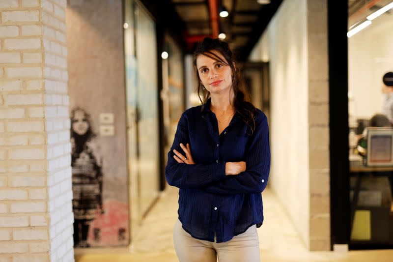 Neta Schreiber, CEO and Co-Founder at SafeUP, a women's safety net application, poses for a photo at a co-working space in Tel Aviv