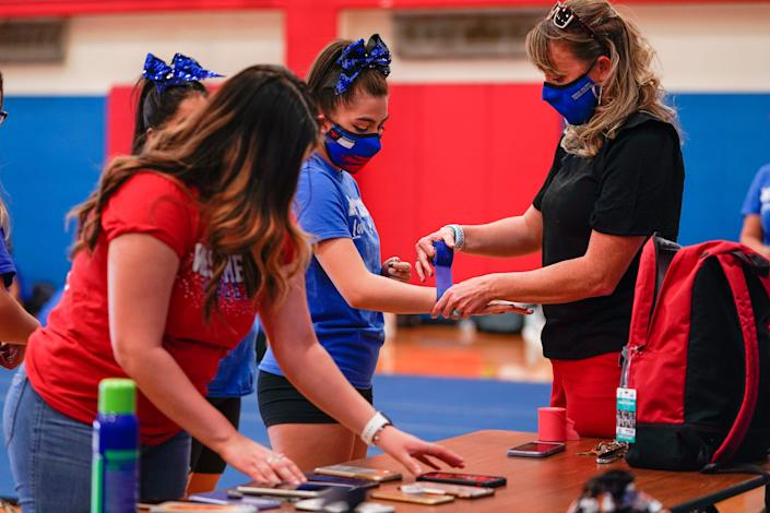 Stephanie Davy arrives at cheer team practice after school.