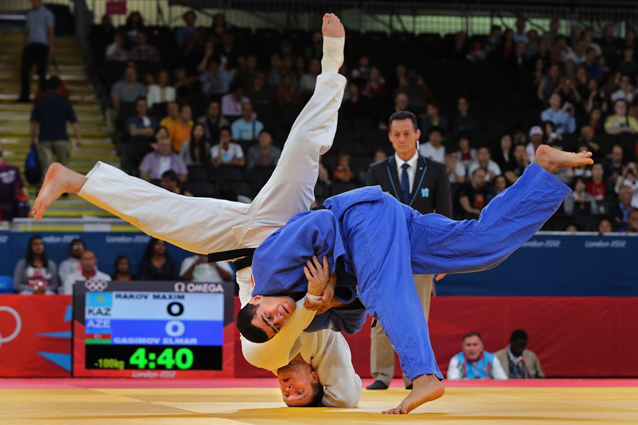 LONDON, ENGLAND - AUGUST 02: Maxim Rakov of Kazakhstan is thrown by Elmar Gasimov of Azerbaijan  on Day 6 of the London 2012 Olympic Games at ExCeL on August 2, 2012 in London, England.  (Photo by Jeff J Mitchell/Getty Images)