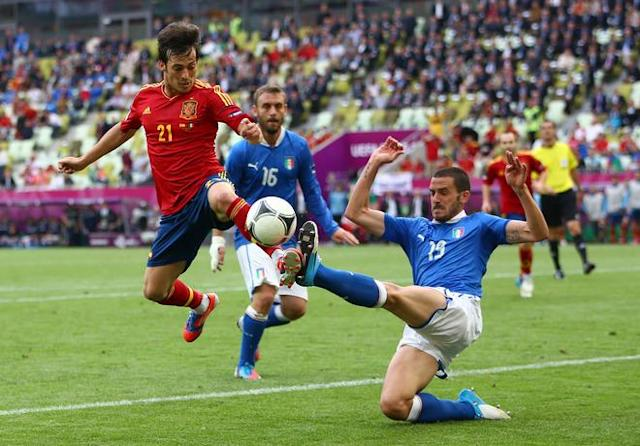 GDANSK, POLAND - JUNE 10: David Silva of Spain and Leonardo Bonucci of Italy compete for the ball during the UEFA EURO 2012 group C match between Spain and Italy at The Municipal Stadium on June 10, 2012 in Gdansk, Poland. (Photo by Michael Steele/Getty Images)