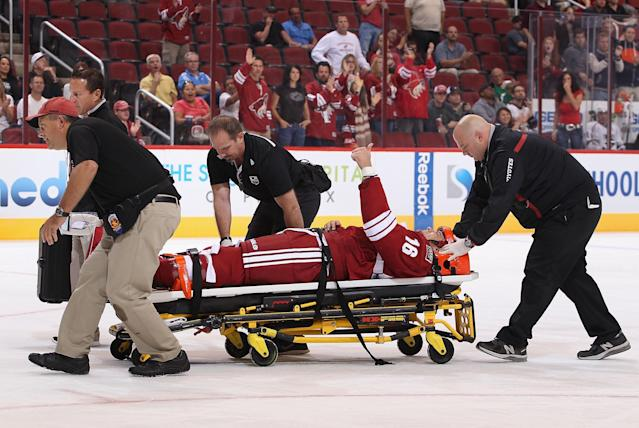 GLENDALE, AZ - SEPTEMBER 15: Rostislav Klesla #16 of the Phoenix Coyotes raises a hand to the crowd as he is removed on a stretcher following an open ice hit from Jordan Nolan (not pictured) of the Los Angeles Kings during the first period of the preseason NHL game at Jobing.com Arena on September 15, 2013 in Glendale, Arizona. (Photo by Christian Petersen/Getty Images)
