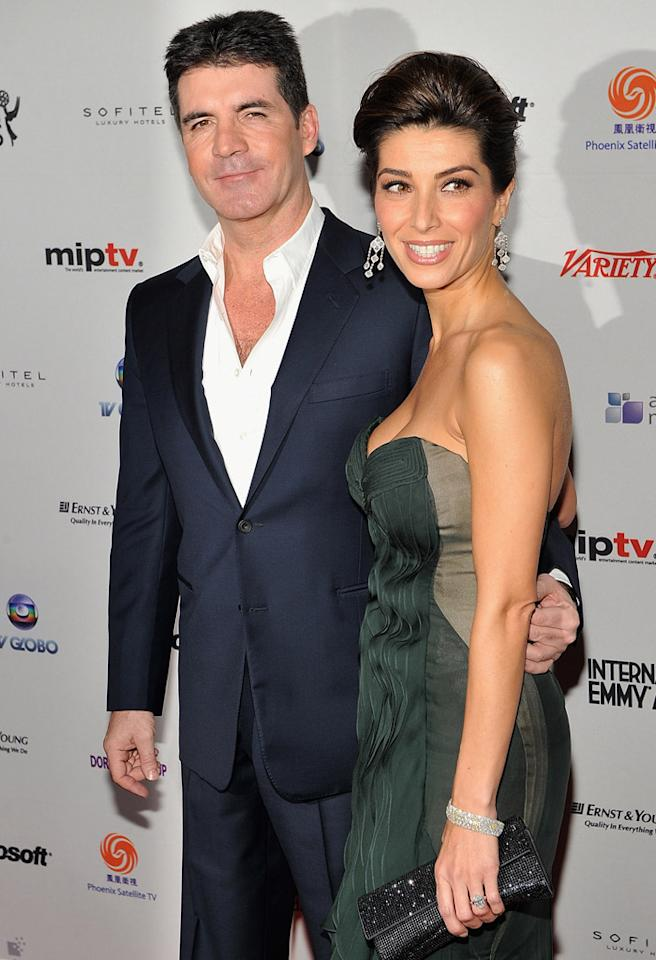 Simon Cowell and his fiancee Mezhgan Hussainy attend the 38th International Emmy Awards at the New York Hilton and Towers on November 22, 2010 in New York City.