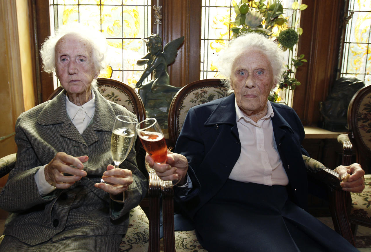 Marie (R) and Gabrielle Vaudremer, 100-year-old Belgian twins, toast as they celebrate their birthday at the Chateau Sous-Bois retirement home in Spa October 2, 2010. Marie and Gabrielle were born in 1910 and are the world's oldest pair of twin sisters, according to the Guinness World Records. REUTERS/Thierry Roge