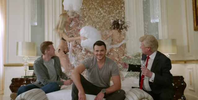 Donald Trump's doppelgänger observes a pillow fight, champagne in hand. (Photo: EminOfficial YouTube channel).