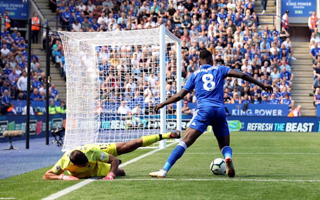 Kelechi Iheanacho wins the ball off Liverpool goalkeeper Alisson in the area leading to Leicester's goal