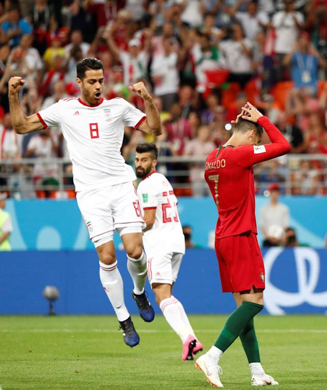 Soccer Football - World Cup - Group B - Iran vs Portugal - Mordovia Arena, Saransk, Russia - June 25, 2018 Portugal's Cristiano Ronaldo reacts after he took a penalty that was saved by Iran's Alireza Beiranvand while Iran's Morteza Pouraliganji celebrates REUTERS/Murad Sezer