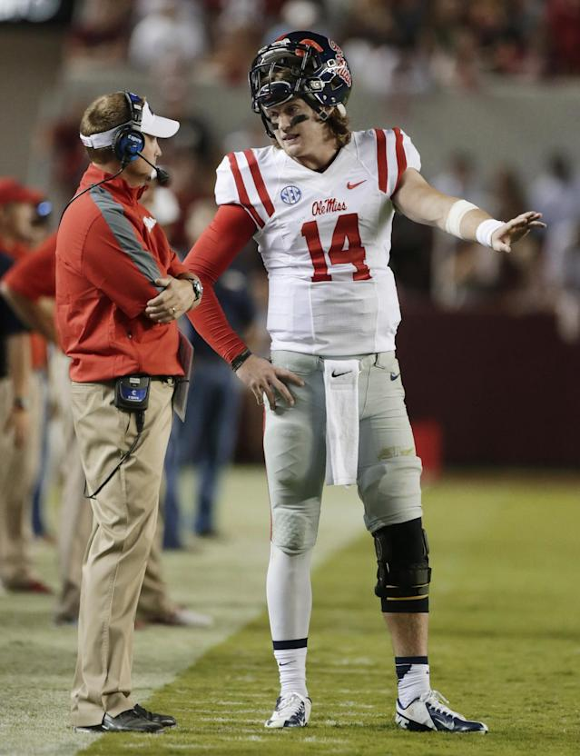 Mississippi coach Hugh Freeze talks with quarterback Bo Wallace in the second half of an NCAA college football game against Alabama in Tuscaloosa, Ala., Saturday, Sept. 28, 2013. Alabama won 25-0. (AP Photo/Dave Martin)